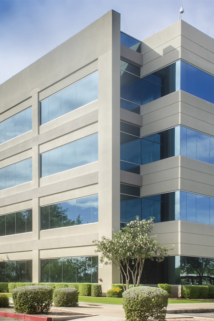 Concrete commercial office building with windows