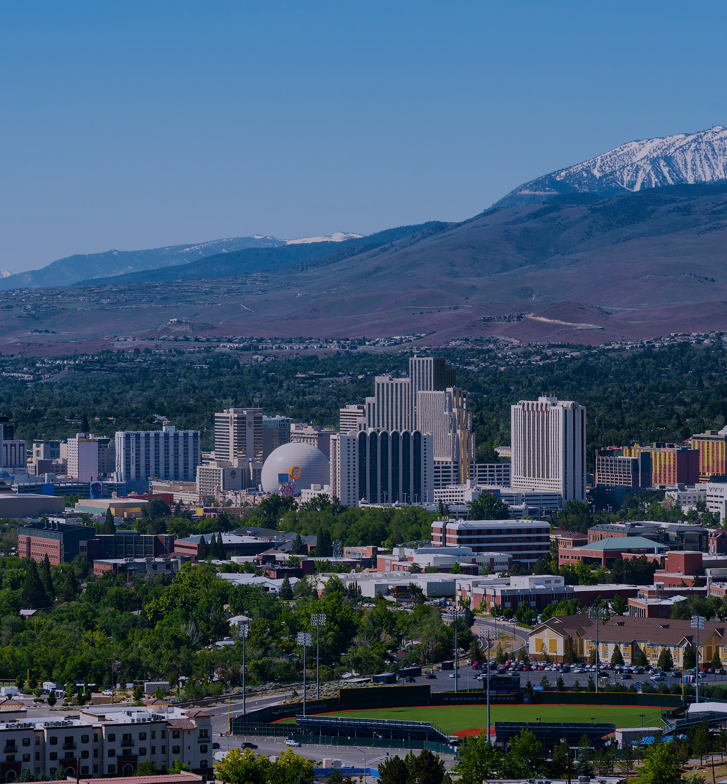Downtown Reno with snow covered mountains