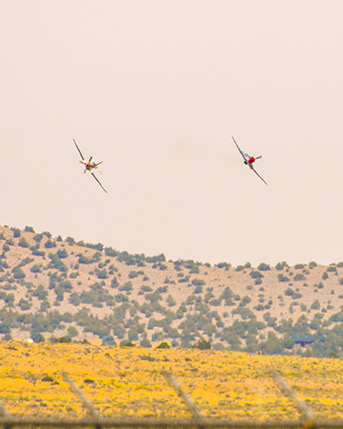 Two Air-Force planes flying side by side in the sky