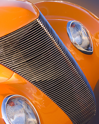 Orange fender of a classic vehicle